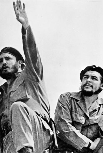 HAVANA, CUBA - JANUARY 1: Picture taken in the early 60's of the Cuban Revolution leader, Fidel Castro (L), and First Secretary of the Communist Party Che Guevara during a meeting in Havana. (Photo credit should read STF/AFP/Getty Images)